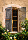 Detail of old vintage wooden window with wild roses provence france Royalty Free Stock Images