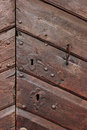 Detail of an old wooden doorway with keyholes and two knob studs Royalty Free Stock Photography