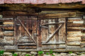 Detail of old wooden textured and weathered barn door Royalty Free Stock Photo