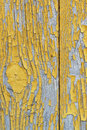 Detail of old wooden wall with the remnants of the leafless paint yellow ochre. Peeling paint reveals the texture of the wood Royalty Free Stock Photo