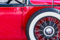 Detail of an oldtimer with spare wheel a red a white sidewall tire Royalty Free Stock Image