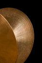 Detail of orchestral cymbals on a black background Stock Photography