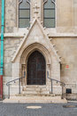 Detail of an ornate Victorian brick archway and wooden door a church. Royalty Free Stock Photo