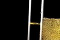 Detail of a pair of flutes of champagne with golden bubbles Royalty Free Stock Photo