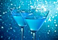 Detail of a pair of glasses of blue cocktail on table Royalty Free Stock Photo