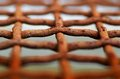 Detail photo of rust wire in the net Royalty Free Stock Photo