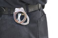 Detail of police officer utility belt with cuffs handcuffs at the back Royalty Free Stock Images
