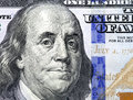 Detail of portrait on one hundred dollar bill benjamin franklin x s Royalty Free Stock Images