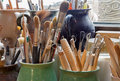 Detail from pottery work room brushes and tools Stock Photography