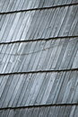 Detail of protective wooden shingle on roof the old as background Stock Photo