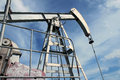 Detail of pump jack in Europe oil field Royalty Free Stock Photo