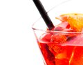 Detail of red cocktail with ice cubes and straw on white background Royalty Free Stock Photo