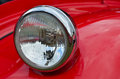 Detail of red headlamp on classic car Royalty Free Stock Photography