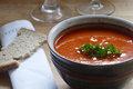 Detail of a red vegetable soup in a pottery bowl Royalty Free Stock Photo