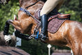 Detail of a rider jumping Royalty Free Stock Photo