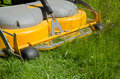 Detail of a riding lawn mower cutting the with Stock Image