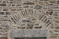 Detail of rocks and stonework texture interest with vegatation Royalty Free Stock Images