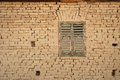 Detail of a romanian earh house traditional mud brick contruction with wooden window Stock Image