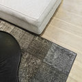 Detail of a room with sofa, rug and coffee table Royalty Free Stock Photo