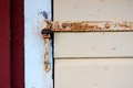 Detail of rusted hinge on wooden door Stock Images