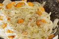 Detail of sauté of onion rings, carrot slices and several spice herbs Royalty Free Stock Photo