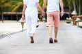 Detail of senior couple walking on wooden jetty away from camera Royalty Free Stock Photos