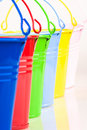 Detail of six coloured buckets Royalty Free Stock Photos