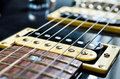 Detail of six string electric guitar closeup selective focus Stock Photos