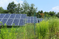 Detail of the solar power station on the meadow in sunny day Royalty Free Stock Photo