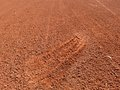 Detail with a sport shoe footprint on a tennis clay court Royalty Free Stock Photo
