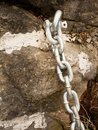 Detail of steel bolt anchor eye in sandstone roc hold steel chain. Royalty Free Stock Photo