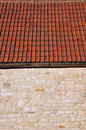 Detail of a Stone Wall and Roof Tiles Royalty Free Stock Image