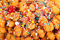 Detail of struffoli neapolitan dessert italian traditional from naples made with fried sweet pastry and honey syrup decorated with Royalty Free Stock Images
