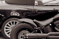 Detail stylish black car and motorcycle. Lifestyle. (Opposites, Royalty Free Stock Photo