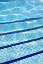 Detail of Swimming pool with sunlight reflecting on the water Royalty Free Stock Photo
