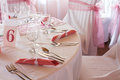 Detail of table set for wedding or another catered event dinner white and pink decoration on the Stock Photography