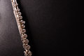 Detail of tansverse flute on black table top view Royalty Free Stock Photo