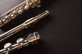 Detail of tansverse flute disassembled three parts on black tabl Royalty Free Stock Photo