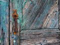 Detail of Textured Old Blue Painted Wooden Door Royalty Free Stock Photo