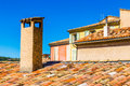 Detail Of The Top Of The Roofs Made Of Red Tiles With Chimneys Royalty Free Stock Photo