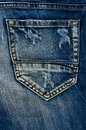 Detail of torn Blue denim, front view  jean Royalty Free Stock Photo