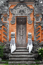 Detail traditional asian balinese carved relief barong door Stock Photos
