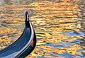 A detail of a traditional gondola floating on water canal in Venice in Italy Royalty Free Stock Photo