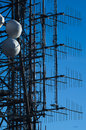 Detail of a transmission tower antennas and satellite dishes on telecommunications Stock Photos