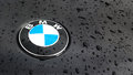Detail of the vent of a BMW logo on a black car, on a rainy day Royalty Free Stock Photo