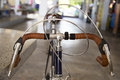 Detail of a vintage bicycle handlebar resting in the narrow street Stock Photography
