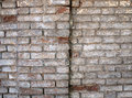 Detail of a wall of an old red brick with white coating Royalty Free Stock Photo