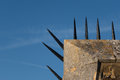 Detail of wall with row of sharp spikes along edge Royalty Free Stock Photo