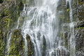 Detail of waterfall cascading over rocks Royalty Free Stock Images
