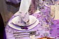Detail of a wedding dinner setting in purple theme Stock Image